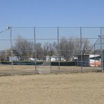 Chain link fence for sports field by Lovewell Fencing