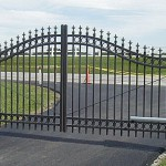 Ornamental metal gate with operators by Lovewell Fencing