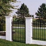 Ornamental metal fence with gate by Lovewell Fencing