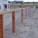 Wood and wire fence by Lovewell Fencing